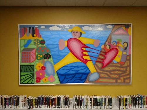 finished mural of a person moving from one place to another with their heart between