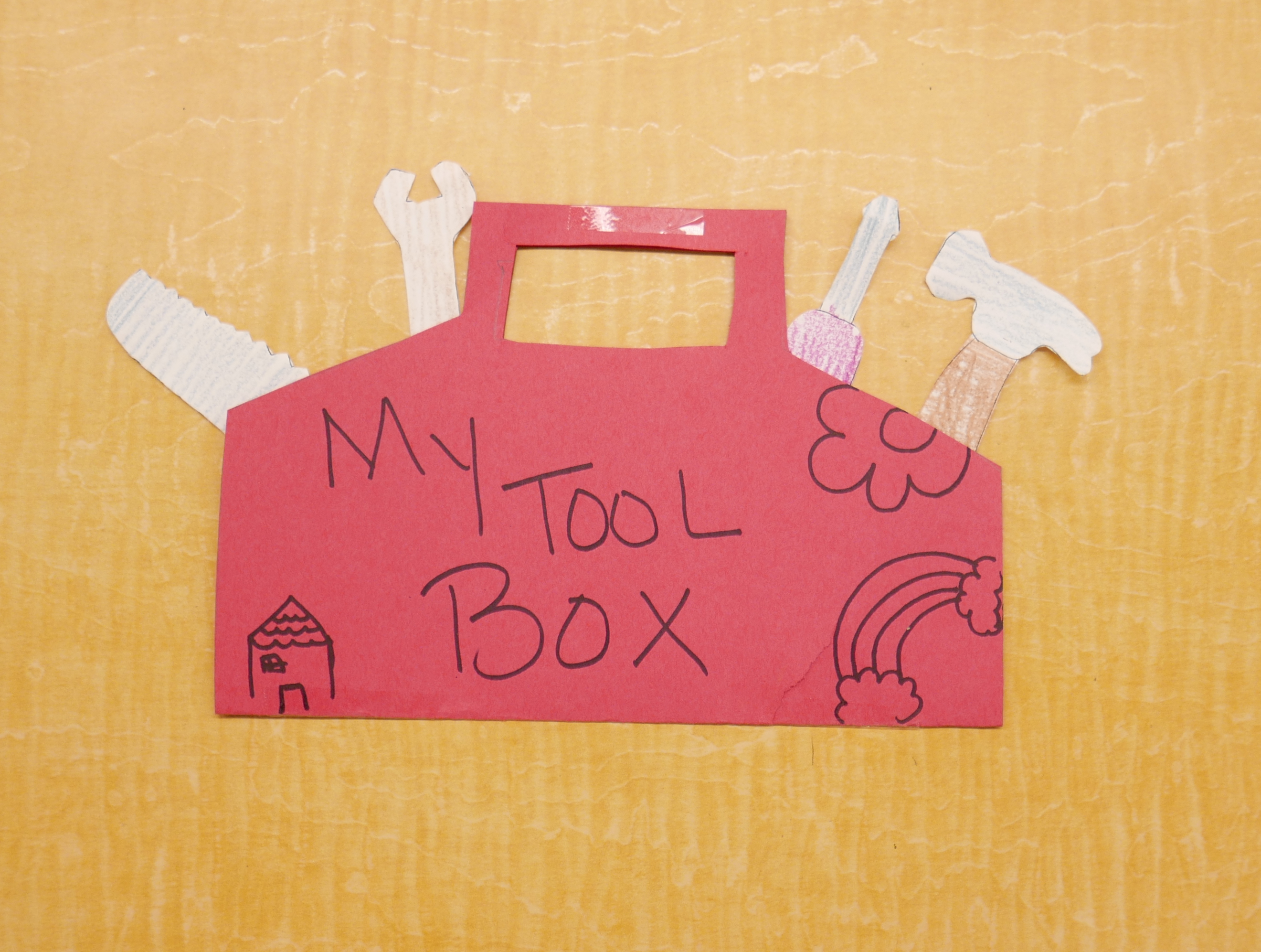 "picture of a red tool box with words ""My toolbox"" and various paper tools coming out of it"