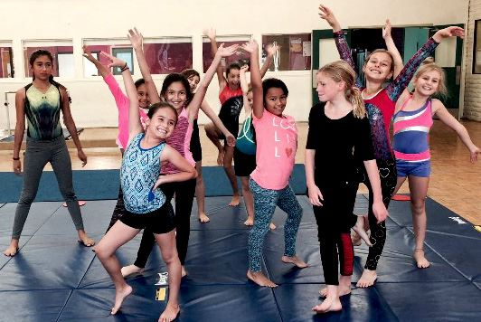 Youth on gymnastics mat