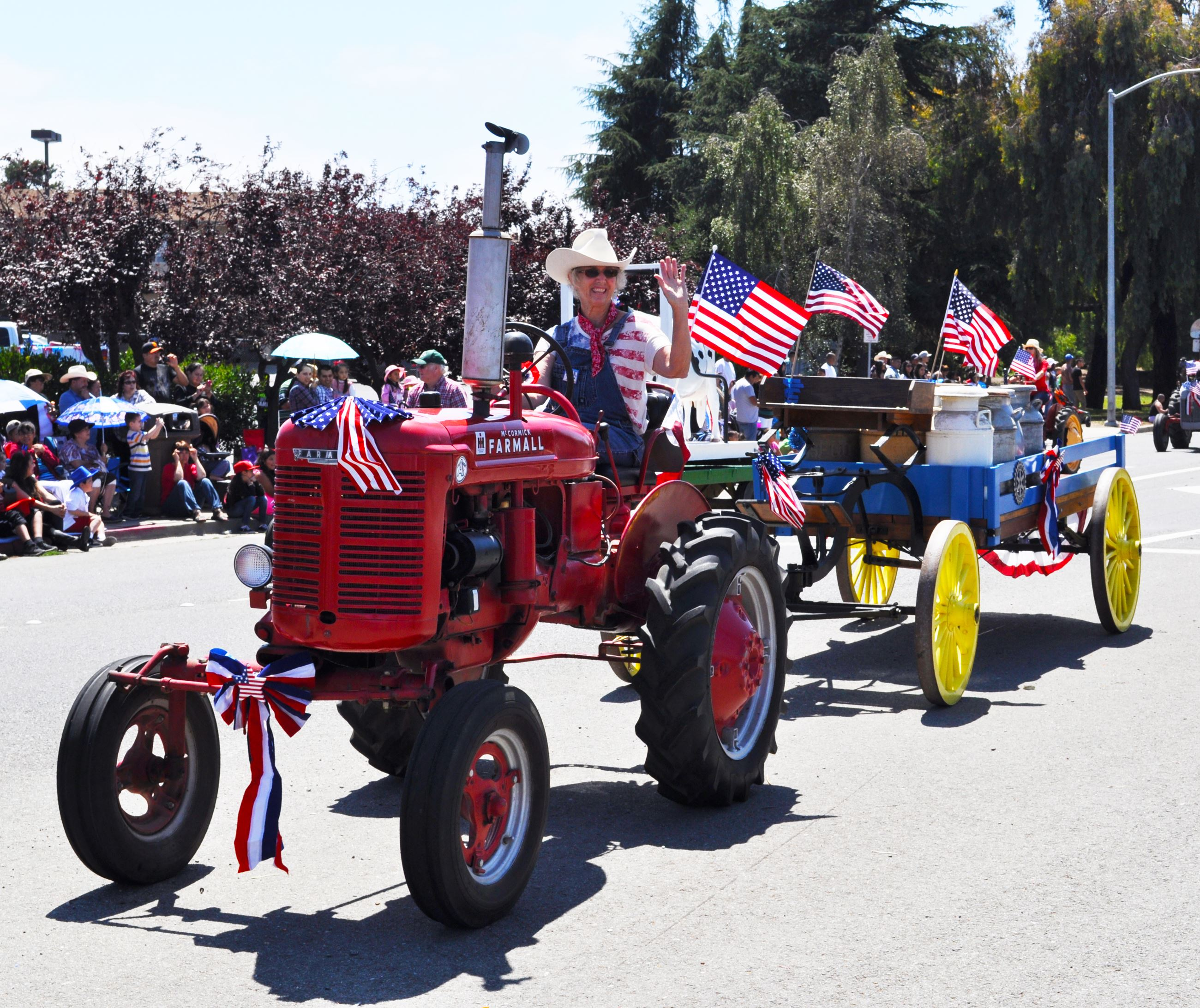 Parade participant waving from a tractor