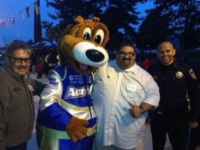 Mascot Dog Posing with Community Members