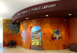 entrance lobby to the Watsonville library with mural