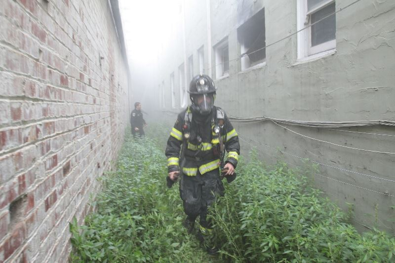 Firefighter Between Buildings
