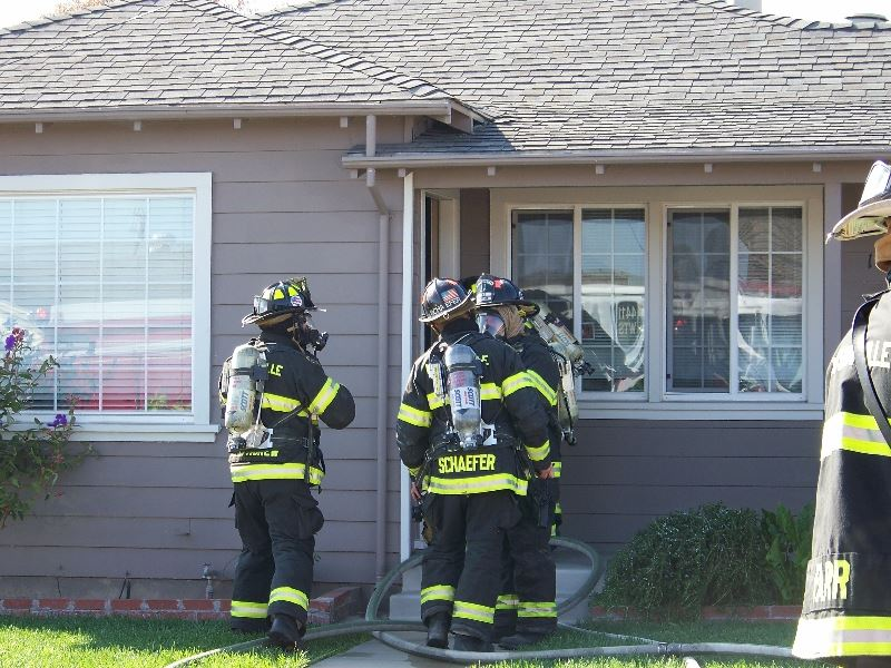 Fire Fighters Outside House