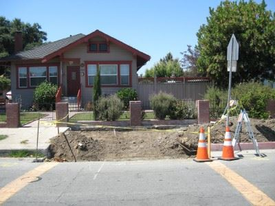 Sidewalk Construction in Front of House