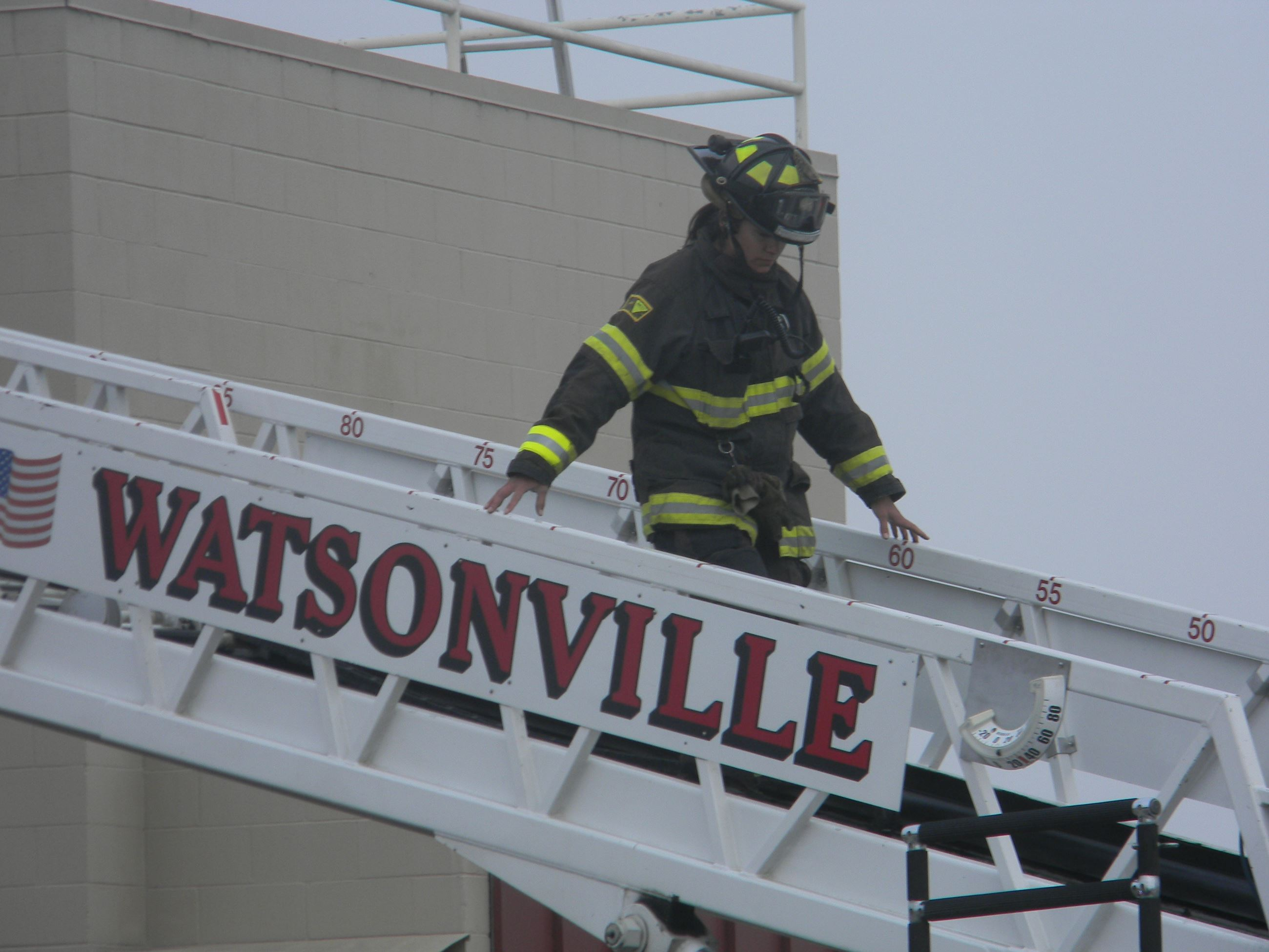 Firefighter walking down a ladder